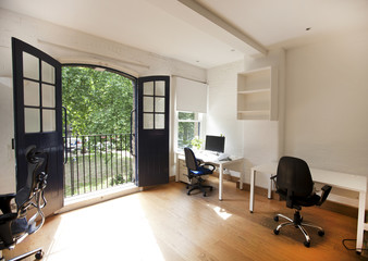 Interior of empty office with desks and chairs