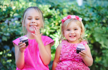 group of two cute fashion little girls eat happy birthday pink c