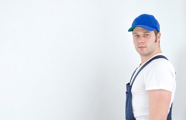 Tradesman in uniform. Space for your text.