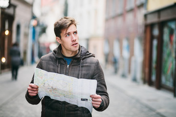 Tourist with city map on a trip in city Wall mural