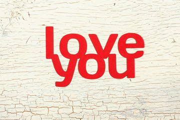 Words  love you  cut from paper