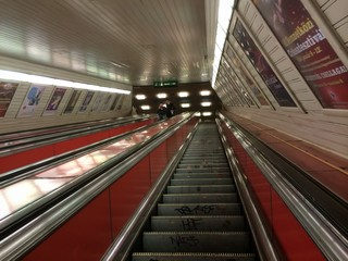 Red escalator at subway station