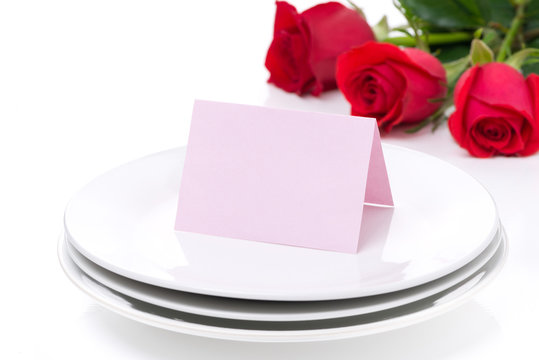 card for congratulation on a plate and roses for Valentine's Day