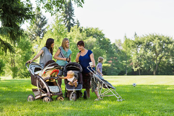 Mothers With Baby Strollers Reading Text Message
