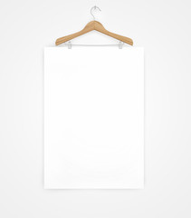 white poster on a wooden hanger