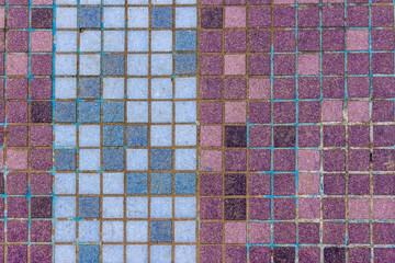 old mosaic tiles of different colors lined verticaly