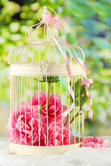 Beautiful decorative cage with beautiful flowers,