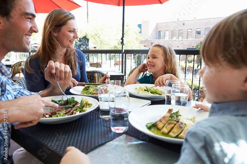 family eating at restaurant - 1200×700