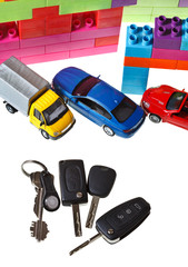 keys, model car, plastic block house