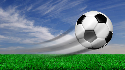 Soccer ball in motion with grass and sky isolated