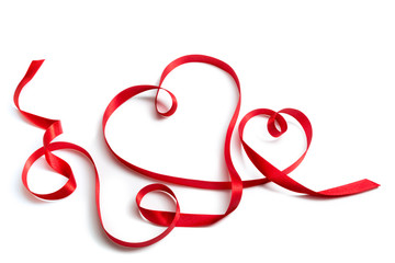 red ribbon that forms a pair of hearts