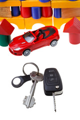 door, vehicle keys, red car model and block house