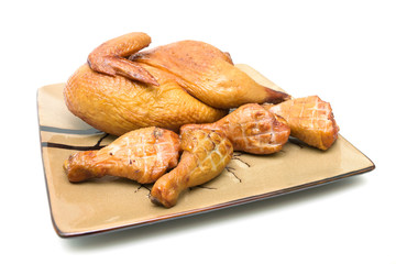roast chicken carcass and chicken legs on a white background