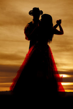 Silhouette couple dancing hands out