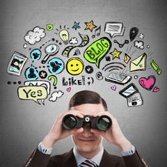 Online life concept. Business man looking through binoculars. Br