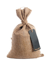 Rough burlap bag with a price tag. Full bag. Isolated