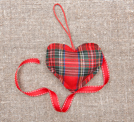 Textile heart and ribbon on sacking