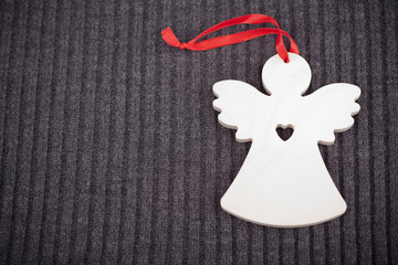 Craft Wooden Angel on Grey Knitted Background