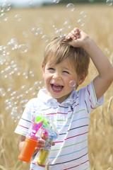 Boy blows bubbles