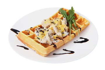 Belgian waffle with a salad of shrimp and mushrooms.