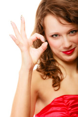 Happy smiling woman with showing ok sign gesture isolated