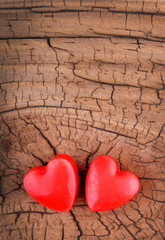 Hearts on Wooden Texture. Valentines Day background.