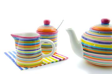 colorful teapot and milk jug and sugar bowl