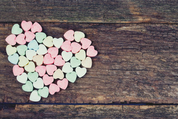 heart-shaped candies on wooden surface