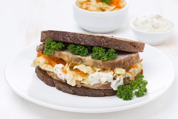 sandwich with coleslaw and baked meat, horizontal photo
