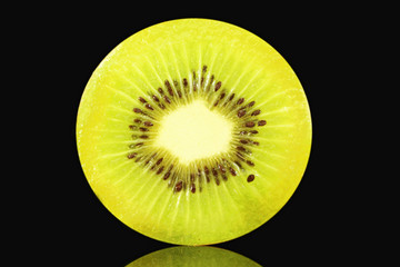 kiwi fruit slice closeup in black background