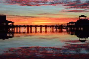 Sunrise at a marina pier with reflection