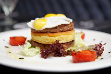 Gourmet burger with potato patty and omelette