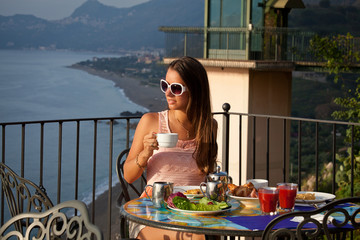 Beautiful woman with breakfast