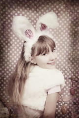 vintage easter bunny girl with funny ears in sepia