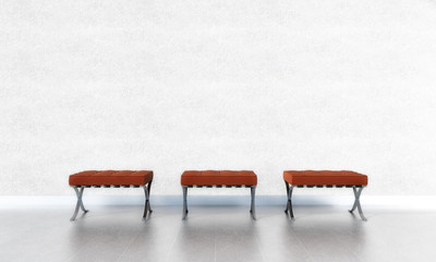 3 rote Stühle vor weißer Wand