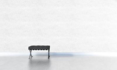 1 schwarzer Stuhl vor weißer Wand