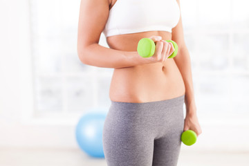 Woman exercising with dumbbells.