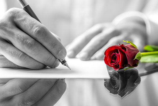 Man writing a love letter to his sweetheart