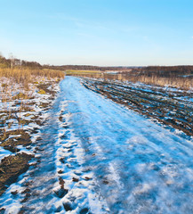 Wall Mural - Blue road. Ice mound on the country road