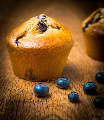 Wall Mural - Blueberry muffins isolated on wood table