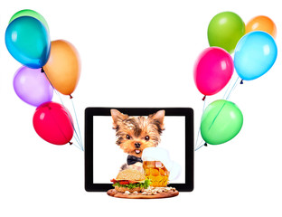 dog with food and balloons on a tablet screen