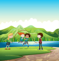 Kids playing skipping rope at the riverbank