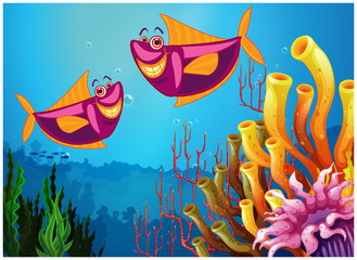 Fishes under the sea near the colorful corals