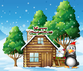 A penguin and a snowman beside the wooden house
