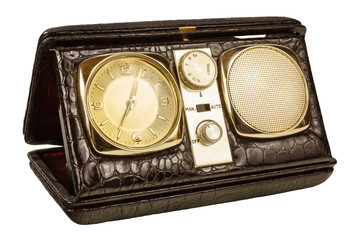 Retro styled image of an old clock radio isolated on white