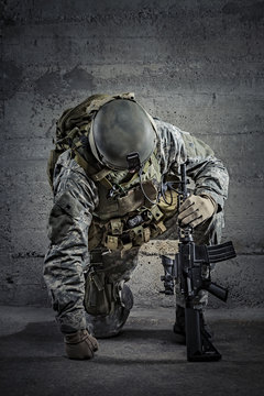 Soldier with rifle and helmet