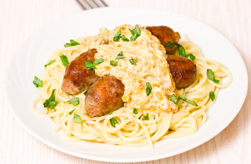 spaghetti with sausage and sauce