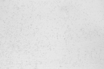 White background of natural cement with spots and scratches.