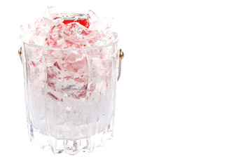 A can of cola drinks in an ice bucket