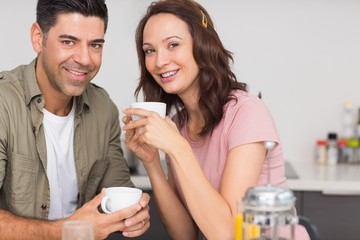 Portrait of a happy loving couple with coffee cup